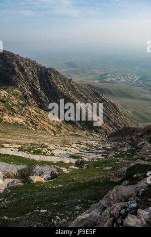 Zigzag road leading to the Syrian orthodox monastery Mar Mattai, (Sant Matthews Monastery) overlooking Mosul, Iraq - Stock Photo