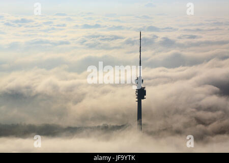 St Chrischona tower above the clouds - Stock Photo