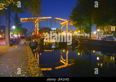 Amsterdam city view with canals and bridges - Stock Photo