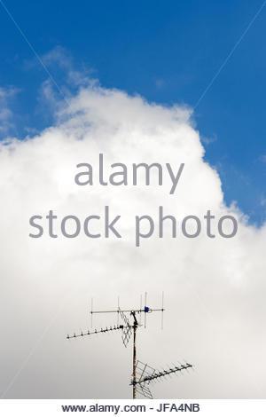 Aerial antenna against blue sky - Stock Photo