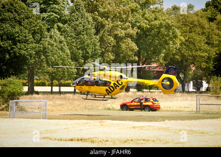 Garching, Germany. 30th June, 2017. ADAC helicopter departing from a wheat field after a call for an emergency doctor. - Stock Photo