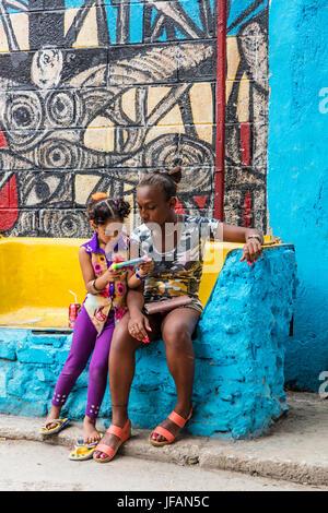 Afro-Cuban MURALS and children in the artist colony of CALLEJON DE HAMEL started by the artist SALVADOR GONZALES - HAVANA, CUBA