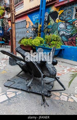 A statue of a bug and murals in the artist colony of CALLEJON DE HAMEL started by SALVADOR GONZALES - HAVANA, CUBA