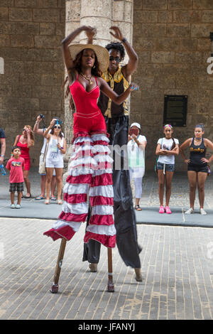 STILT WALKERS entertain the crowd in the PLAZA DE ARMAS located in Habana Vieja - HAVANA, CUBA - Stock Photo