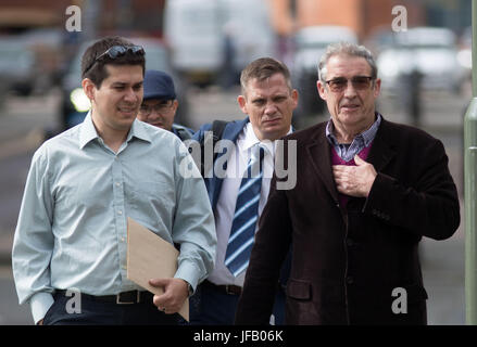 PC Keith Burgess (centre) arrives with unidentified men at Guildford Crown Court in Guildford, to be sentenced for - Stock Photo