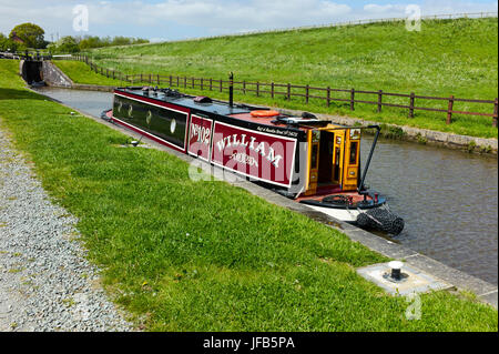 Canal boat waiting to go through locks on Llangollen canal - Stock Photo