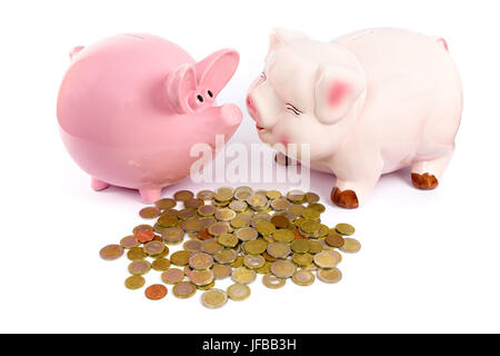 Two piggy banks with euro coins on white - Stock Photo