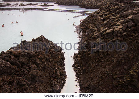 People relaxing in the geothermal hot springs at Blue Lagoon. - Stock Photo