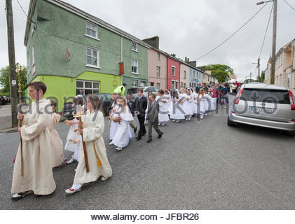 A Corpus Christi procession parades through Milltown, Ireland. - Stock Photo