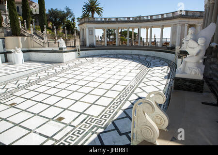 The Neptune Pool at Hearst Castle, empty for restoration, is surrounded by a sitting area and sculptures. - Stock Photo