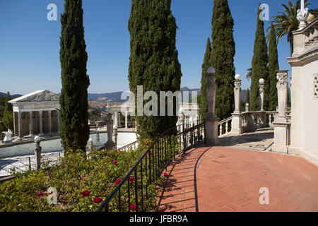 The Neptune Pool and veranda at Hearst Castle are landscaped with trees and plants. - Stock Photo