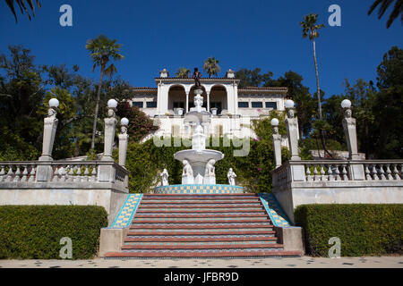 The staircase leading from cottage House A, Casa del Mar, to the Neptune Pool, fountain and veranda at Hearst Castle. - Stock Photo