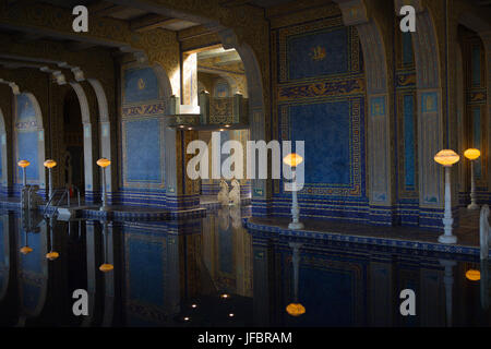 The Roman Pool at Hearst Castle, styled after an ancient Roman bath, is tiled with mosaic patterns in blue and gold, - Stock Photo
