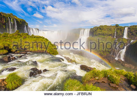 A rainbow at Iguazu waterfalls on the border of Argentina and Brazil in South America. - Stock Photo