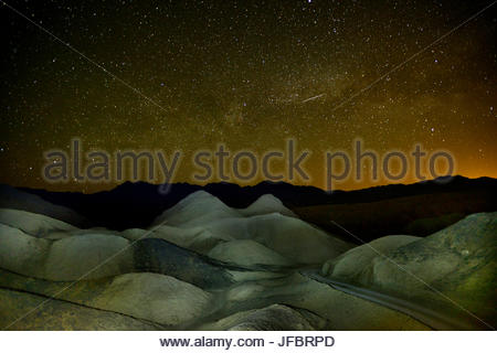 A starry sky over Twenty Mule Team Canyon. - Stock Photo