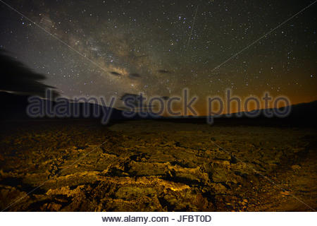 A starry sky over salt deposits along West Side Road. - Stock Photo