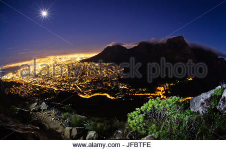 A long exposure of the view from Lion's Head on the Table Mountain, and parts of the illuminated city of Cape Town. - Stock Photo