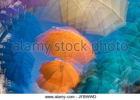 Umbrellas on display in the Caudan Waterfront, a shopping center in the capital of Port Louis. - Stock Photo