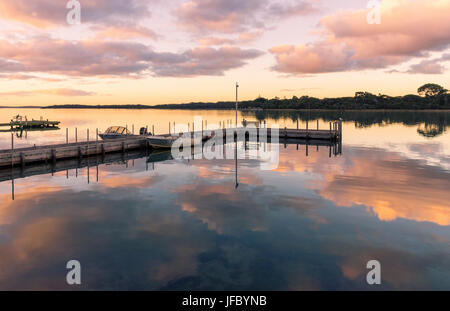 Sunset over a jetty on Hardy Inlet, Augusta, Western Australia - Stock Photo