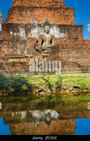Wat Mahathat Temple at Sukhothai Historical Park, a UNESCO World Heritage Site in Thailand - Stock Photo
