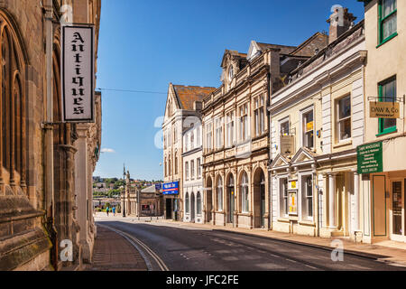 18 June 2017: Barnstaple, Devon, England, UK - Fine old buildings in Cross Street. Queen Anne's Walk has the statue - Stock Photo