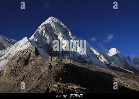 Snow capped mount Pumori - Stock Photo