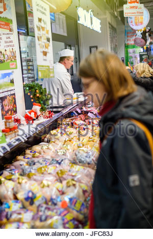 Woman buying meat in French suoermarket - Stock Photo
