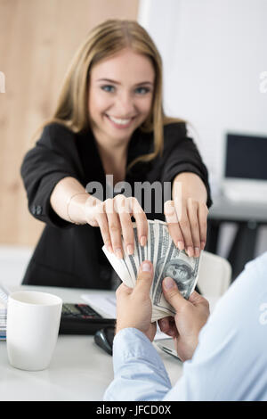 Woman taking batch of hundred dollar bills. Venality, bribe, corruption concept - Stock Photo