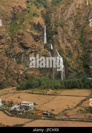 Waterfall in Tal, Nepal - Stock Photo
