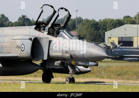 FLORENNES, BELGIUM - JUN 15, 2017: Greek Air Force F-4 Phantom fighter jet taxiing towards the runway - Stock Photo