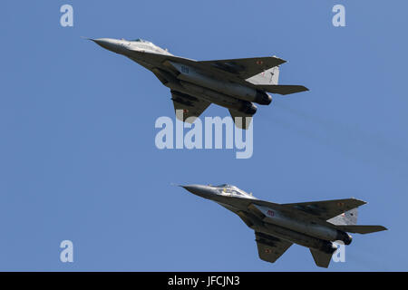 FLORENNES, BELGIUM - JUN 15, 2017: Two Polish Air Force MiG-29 Fulcrum fighter jet flying over the FLorennes Airbase. - Stock Photo