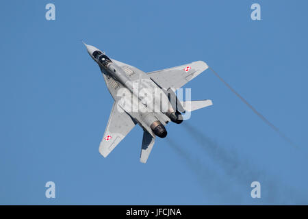 FLORENNES, BELGIUM - JUN 15, 2017: Polish Air Force MiG-29 Fulcrum fighter jet flying over the Florennes Airbase. - Stock Photo