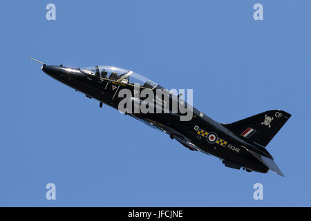 FLORENNES, BELGIUM - JUN 15, 2017: Royal Air Force BAe Hawk T1 trainer jet flying by over Florennes Airbase. - Stock Photo