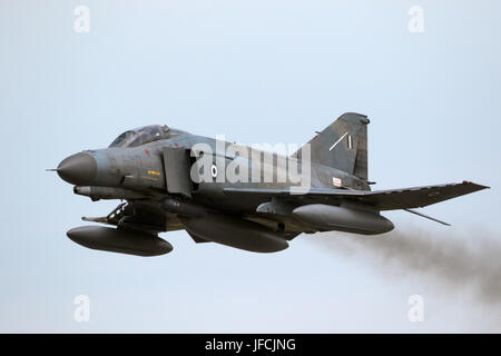 FLORENNES, BELGIUM - JUN 15, 2017: Greek Air Force F-4 Phantom fighter jet flyby over Florennes Airbase - Stock Photo