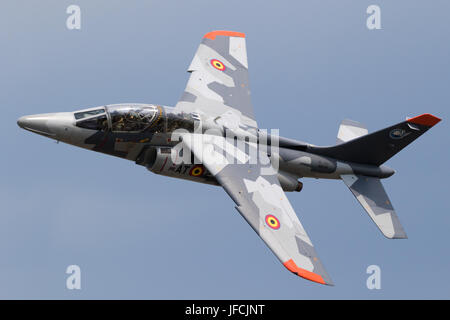 FLORENNES, BELGIUM - JUN 15, 2017: Belgian Air Force Alpha Jet trainer jet flying by over Florennes Airbase. - Stock Photo