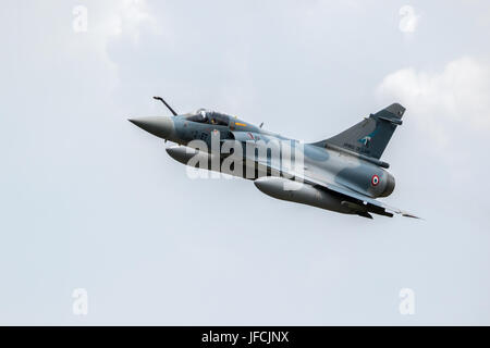 FLORENNES, BELGIUM - JUN 15, 2017: French Air Force Dassault Mirage 2000 fighter jet flyby over Florennes Airbase - Stock Photo