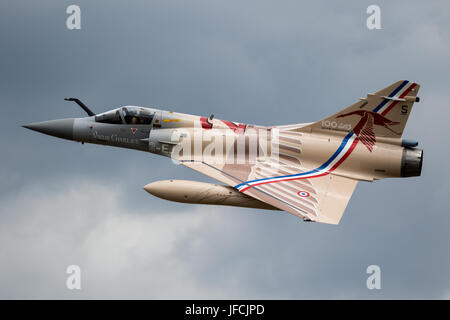 FLORENNES, BELGIUM - JUN 15, 2017: Special painted French Air Force Dassault Mirage 2000 fighter jet flyby over - Stock Photo