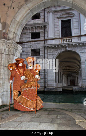 VENICE - FEBRUARY 5: Costumed people near the Piazza San Marco during Venice Carnival on February 5, 2013 in Venice, - Stock Photo