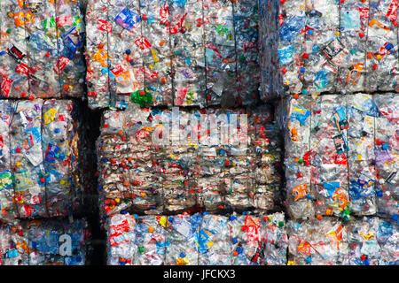 ARNHEM, THE NETHERLANDS - MARCH 15: Clear plastic bottles in bales at an undisclosed recycling facility. March 15, - Stock Photo