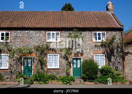 Picture shows: Traditional flint and brick houses at Castle Acre, Norfolk © Julian Wyth. All rights reserved. No unauthorised use. Stock Photo