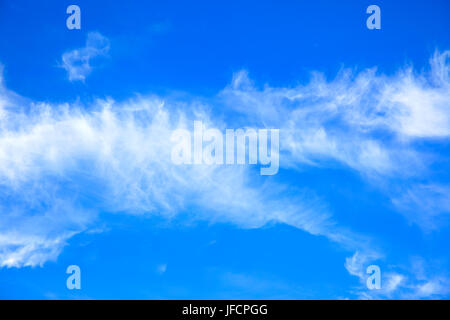 Stripe of clouds in the sky - background and space for your own text - Stock Photo