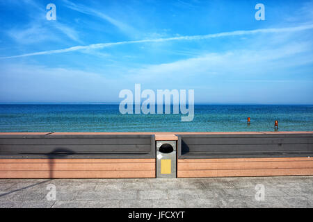 Bench on promenade at Baltic Sea waterfront in Hel town and Peninsula, Poland - Stock Photo