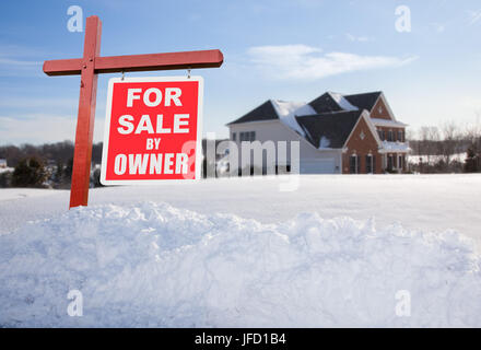 For sale sign in front of large USA home - Stock Photo