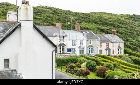 A row of old terraced houses, with pretty, well kept, front gardens, near the seaside in Mortehoe, Devon, England, - Stock Photo