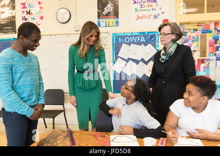 Joined by faculty members of Excel Academy Public Charter School, First Lady Melania Trump shares a moment with - Stock Photo