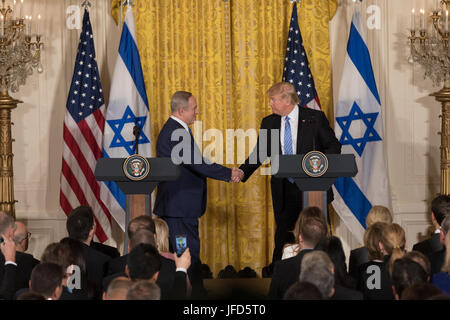 President Donald Trump and Israeli Prime Minister Benjamin Netanyahu shake hands during their joint press conference, - Stock Photo