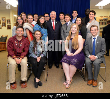 U.S. Secretary of State Rex Tillerson poses for a photo with the Arctic Youth Ambassadors at the Morris Thompson - Stock Photo
