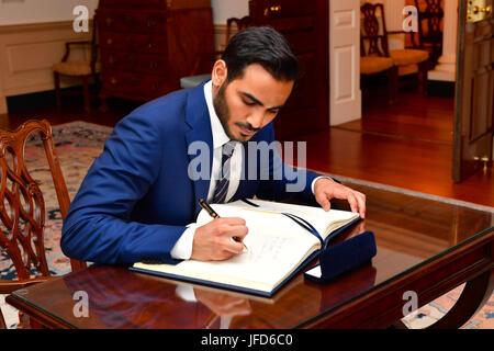 Qatari Secretary to the Emir for Investments Sheikh Mohammed bin Hamad bin Khalifa Al Thani signs U.S. Secretary - Stock Photo
