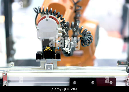 Automatic robot arm with imaging sensor in assembly line working in factory. Smart factory industry 4.0 concept. - Stock Photo