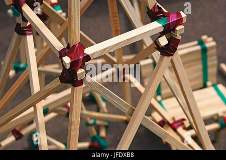 Construction from wooden slats connected by duct tape - Stock Photo